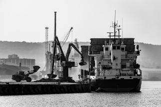 Unloading of bulk materials in the port. The port quay in Gdynia